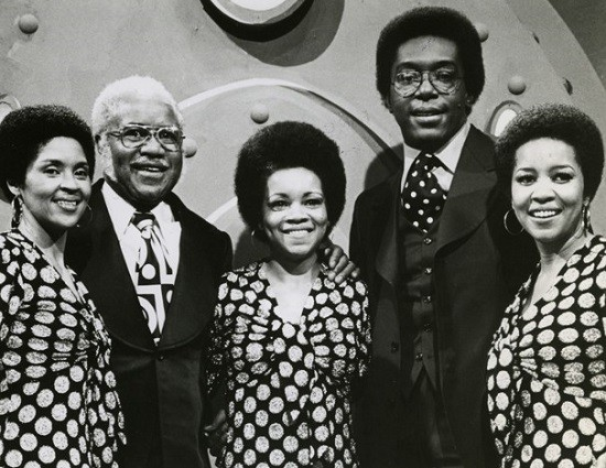 The Staple Singers with Soul Train host Don Cornelius in 1974. - PUBLICITY PHOTO
