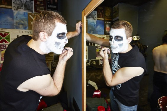 Steven Sluhan applies makeup in tribute to post-Danzig drummers Brian Damage and Robo. - THEO WELLING