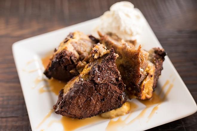 The bread pudding brunch entree features an apple pie potsticker and bourbon caramel. - MABEL SUEN