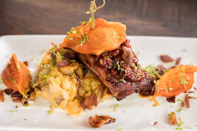 """The """"For The Party"""" dinner entree includes St. Louis-style ribs, a buffalo chicken potsticker, bacon-cheddar mashed potatoes and bleu cheese sauce. - MABEL SUEN"""