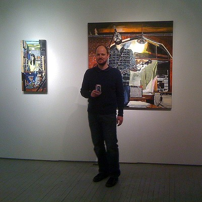 Dana Smith with his painting of Tim Rakel at the Schlafly Tap Room
