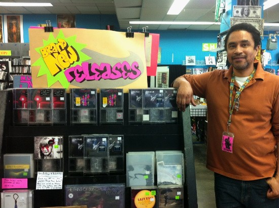 Vintage Vinyl General Manager, Leon Reed, with some of this week's releases - CHRISSY WILMES