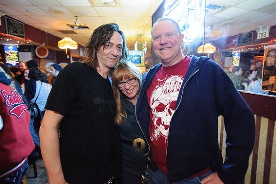 The man of the hour (right) with some fans. - JASON STOFF