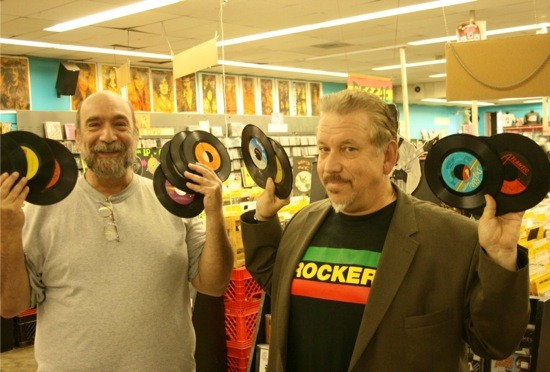 """Lew Prince (left) and his business partner, Tom """"Papa"""" Ray, at Vintage Vinyl. - JON SCORFINA FOR RIVERFRONT TIMES."""