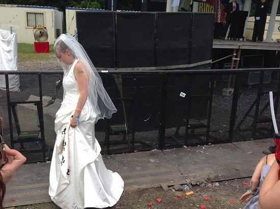 The bride approaches the stage. - DREW AILES