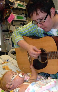 Merrell performs for a young fan.