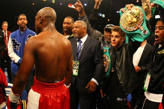 Justin Bieber carried Floyd Mayweather, Jr.'s championship belts to the ring on Saturday. No, seriously. This actually happened. - ZIMBIO.COM