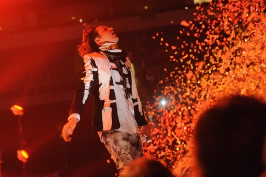 Win Butler of the Arcade Fire gets off on confetti. See more photos. - JASON STOFF