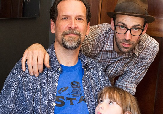 Co-owners Tim Hendrickson and Jeremy Miller with a young record fan. - MABEL SUEN