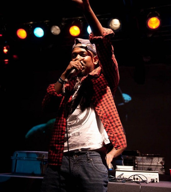 Kendrick Lamar performing live, courtesy of LA Weekly. - TIMOTHY NORRIS
