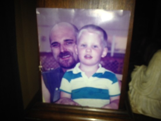 A picture of a picture of the Rooster and myself, predicting future hair trends.