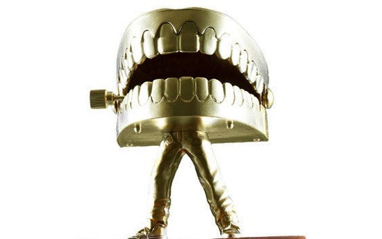 Fun fact: The legs from this trophy, which we made in March for the Standup Throwdown, came from a Justin Bieber action figure. You can still see the B on his hip.