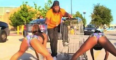 Mr. Ghetto's hype man deconstructs social norms in the parking lot of a Super Wal-Mart