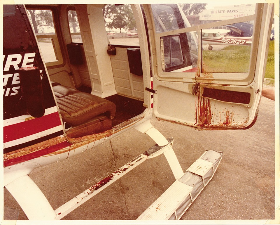 Barklage kept several photos in his scrapbook showing his helicopter covered in Oswald's blood. - ALLEN BARKLAGE PERSONAL EFFECTS
