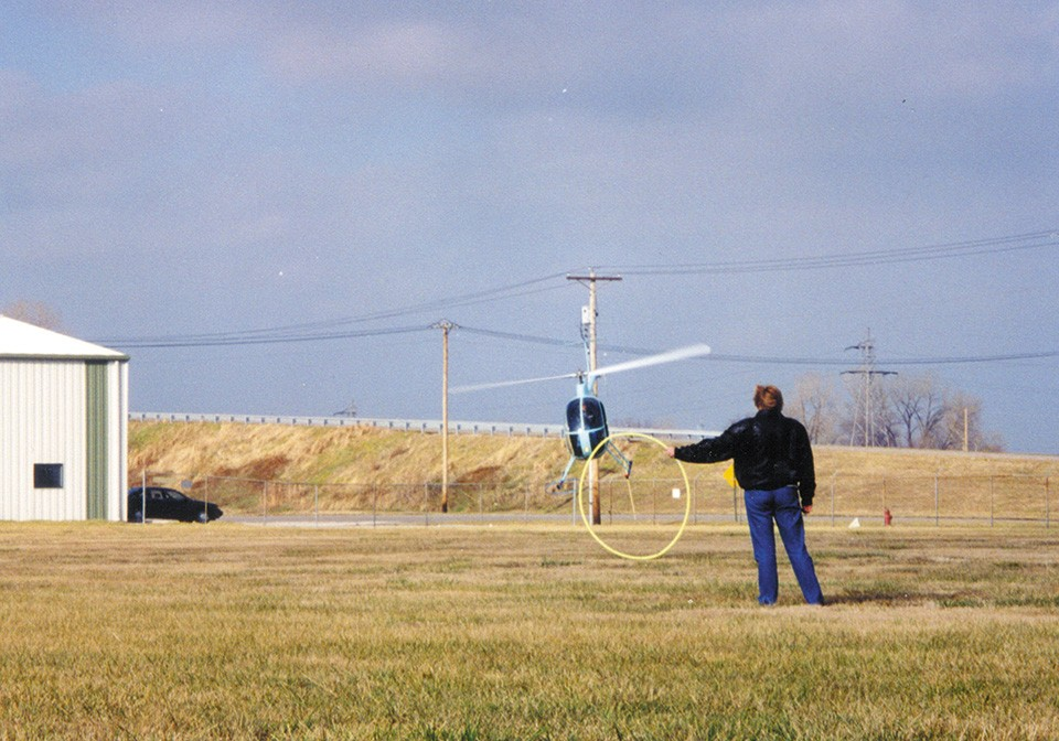 Barklage performed aerial stunts in his Mini 500 helicopter. In this photo, he's practicing snatching a hula hoop with the craft's landing gear. - COURTESY OF GENE HOFFMEYER