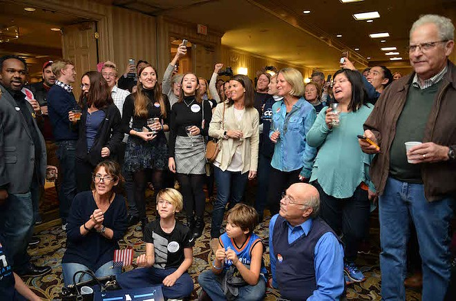 Supporters of Cort VanOstran watch election returns on Tuesday, November 6. - TOM HELLAUER