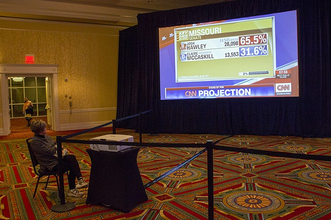 Campaign volunteer Debbie Grayson watches the early results. - DANNY WICENTOWSKI