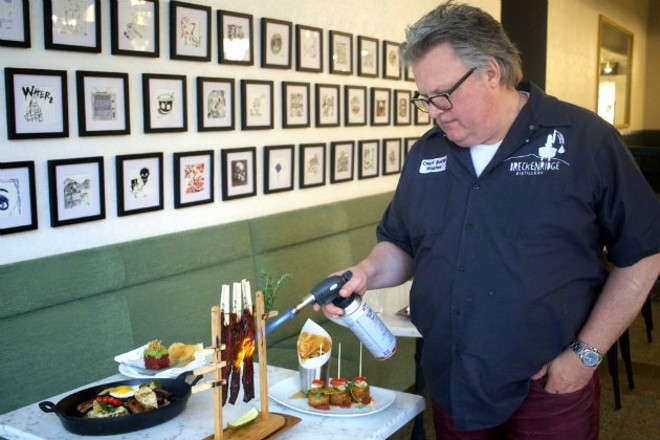 "Acclaimed Chef David Burke torches the ""Clothesline Bacon""' tableside. - CHERYL BAEHR"