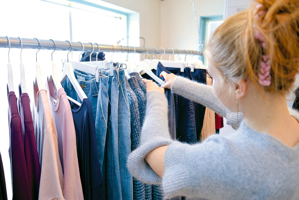 Maya Harlan attends to the racks at LAUNCH, a two-year-old boutique on the Hill.