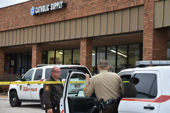 St. Louis County police still had the Catholic Supply store taped off this morning. - DOYLE MURPHY