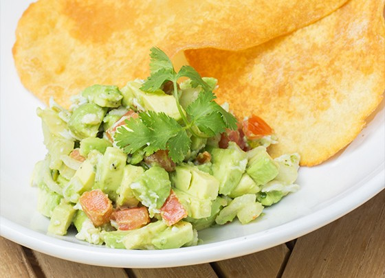 """""""Avocado & Crab Salad"""" served with fried Indian bread."""