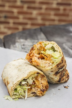 "The ""Mississippi Nights Club"" wrap features turkey, roast beef, bacon, pepper cheese, lettuce, tomato, red onion, spicy red pepper spread, crushed Billy Goat chips and pepper mayo. - MABEL SUEN"