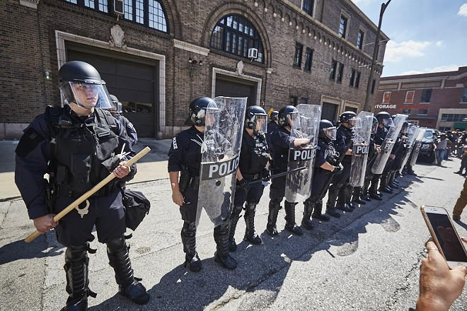 St. Louis officers face off with protesters on September 15, 2017, the day a former officer was acquitted of murdering a suspect. - PHOTO BY THEO WELLING