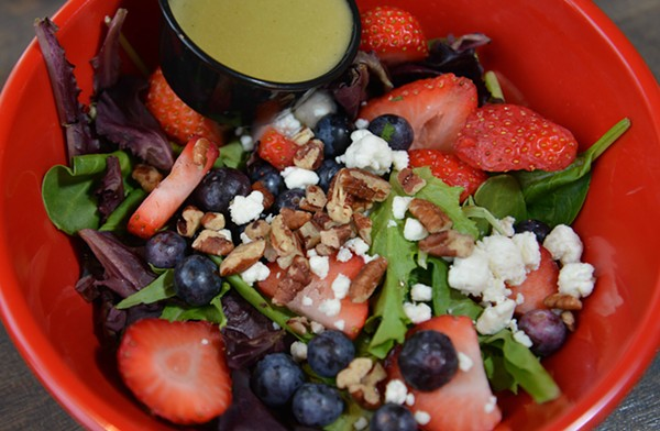 """The """"Berrylicious"""" salad has strawberries, blueberries, pickled red onions, goat cheese, pecans, spring mix and housemade lemon basil vinaigrette. - TOM HELLAUER"""