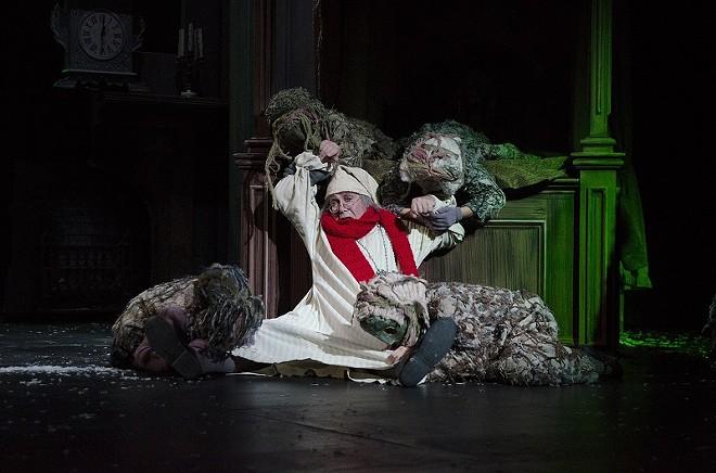 Scrooge has had better nights. - COURTESY OF THE NEBRASKA THEATRE CARAVAN
