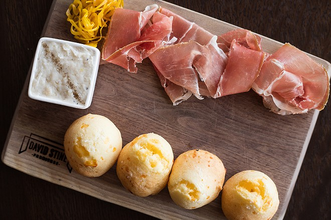 """""""Dia's Cheese Bread,"""" with country ham, smoked lardo and pickled vegetables, is named after the woman who inspired the restaurant. - MABEL SUEN"""