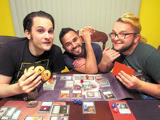 At the Khulies' Ballwin rehearsal space, Magic: The Gathering is serious business. - JULIA BROOKS
