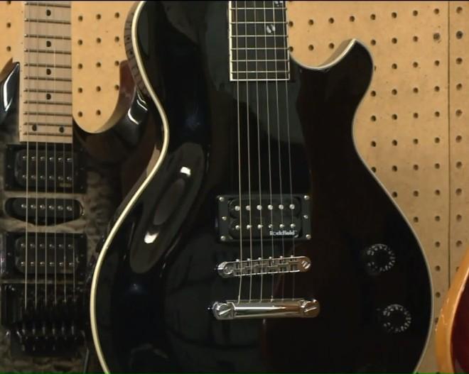 Blake Shelton model guitars, like this one shown in a Fox2 video, were stolen. - FOX2
