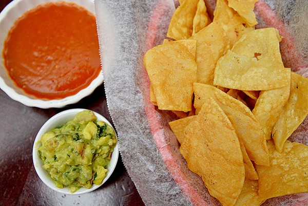 Homemade guacamole and salsa pair well with tortilla chips and other dishes. - TOM HELLAUER