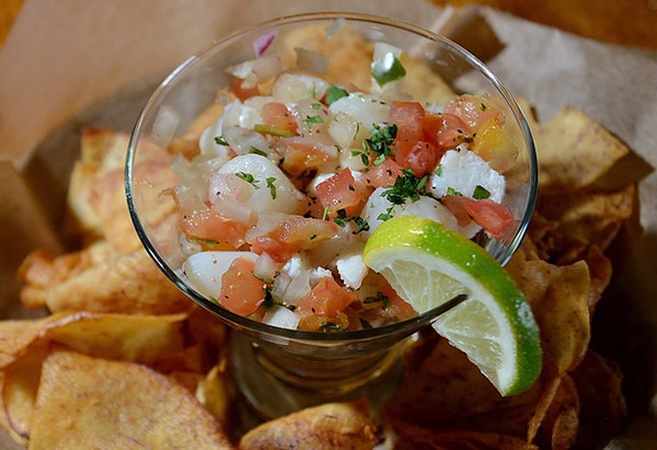 Ceviche, made of conch, shrimp, scallops and whitefish, is served with taro chips. - TOM HELLAUER