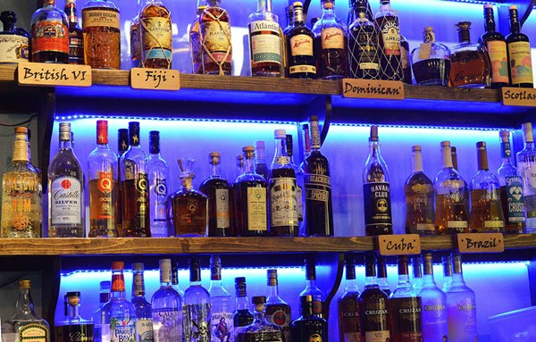 Rums are divided by country of origin behind the bar. - TOM HELLAUER