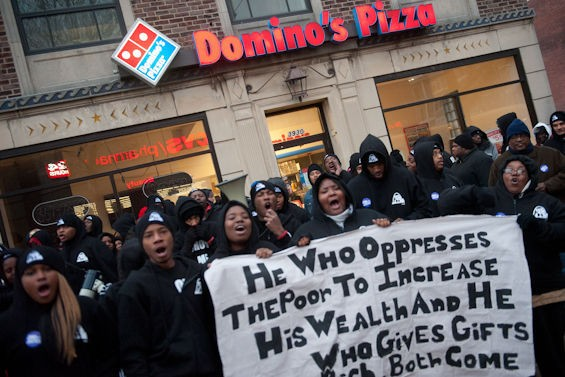 St. Louis fast food workers and their supporters have protested low wages for years. Here they are demonstrating in December 2013. - JON GITCHOFF