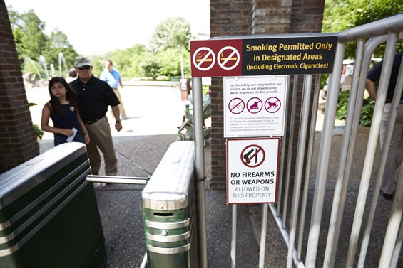 A sign at the zoo bars visitors from bringing in firearms. - PHOTO BY THEO WELLING