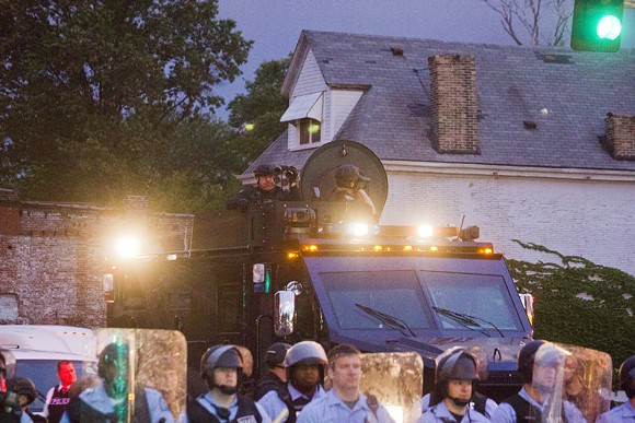 Protesters and residents were outraged at  the presence of armored police vehicles and heavily armed officers.