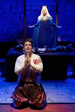 Hamlet (Casey Boland, kneeling) receives a vision of Mary (Caitlin Mickey). - PROPHOTOSTL.COM