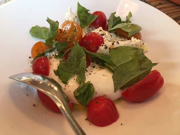 Burrata with basil, tomatoes and fresh-cracked pepper. - PHOTO BY SARAH FENSKE