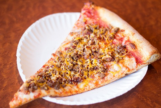 A slice of Racanelli's pizza. - PHOTO BY MABEL SUEN