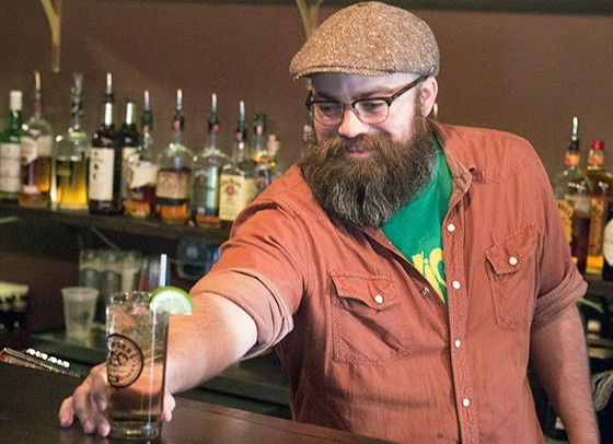 Brandon Cavanagh behind the bar at the Demo. - PHOTO BY MABEL SUEN