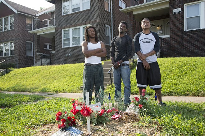 Franks with friends at the makeshift memorial for VonDerrit Myers in the Shaw neighborhood. - STEVE TRUESDELL