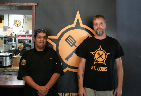 Joel Crespo (left) with Brian Hardesty, his partner in Guerilla Street Food. - PHOTO BY JOHNNY FUGITT