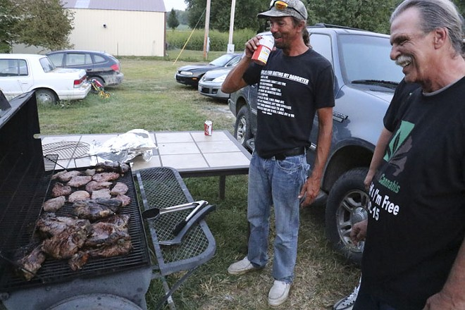 Mizanskey after his release, barbecuing with son Robbie. - RAY DOWNS