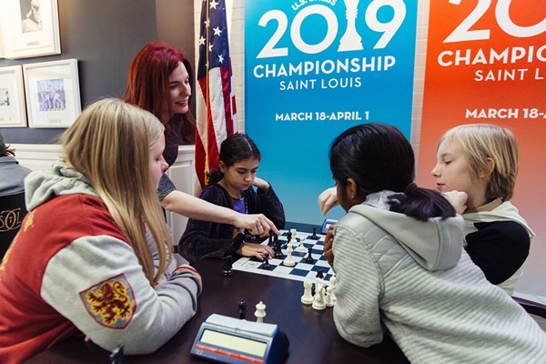 Jennifer Shahade, at left, offers advice to a group of Girl Scouts at a chess merit badge workshop. - COURTESY THE SAINT LOUIS CHESS CLUB