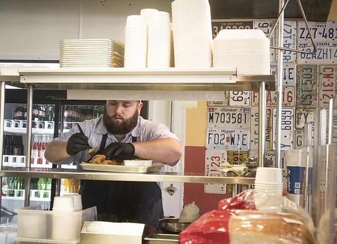 Chef Rick Lewis in the kitchen. - MABEL SUEN