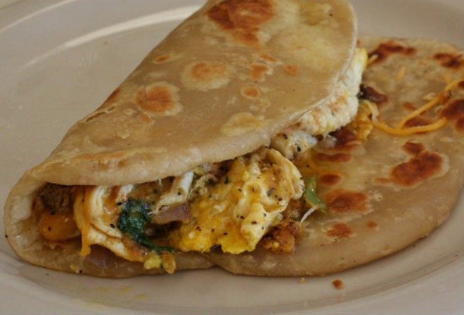 The Chapati Egg Cheese Wrap appetizer at Olive Green International Cuisine. - PHOTO BY JOHNNY FUGITT