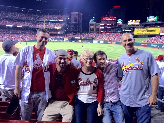 Chris Sanna's mom shared this photo of her family enjoying the Cardinals game — just before Chris, center right, was shot. - IMAGE VIA GOFUNDME