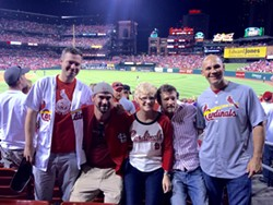 Chris Sanna's mom shared this photo of her family enjoying Friday's Cardinals game — just before Chris, center right, was shot. - IMAGE VIA GOFUNDME